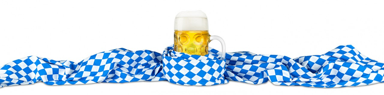 (c) by stockphoto-graf - Oktoberfest beer mug with bavarian flag isolated on white background (Microstock Bildagentur Fotolia.de)